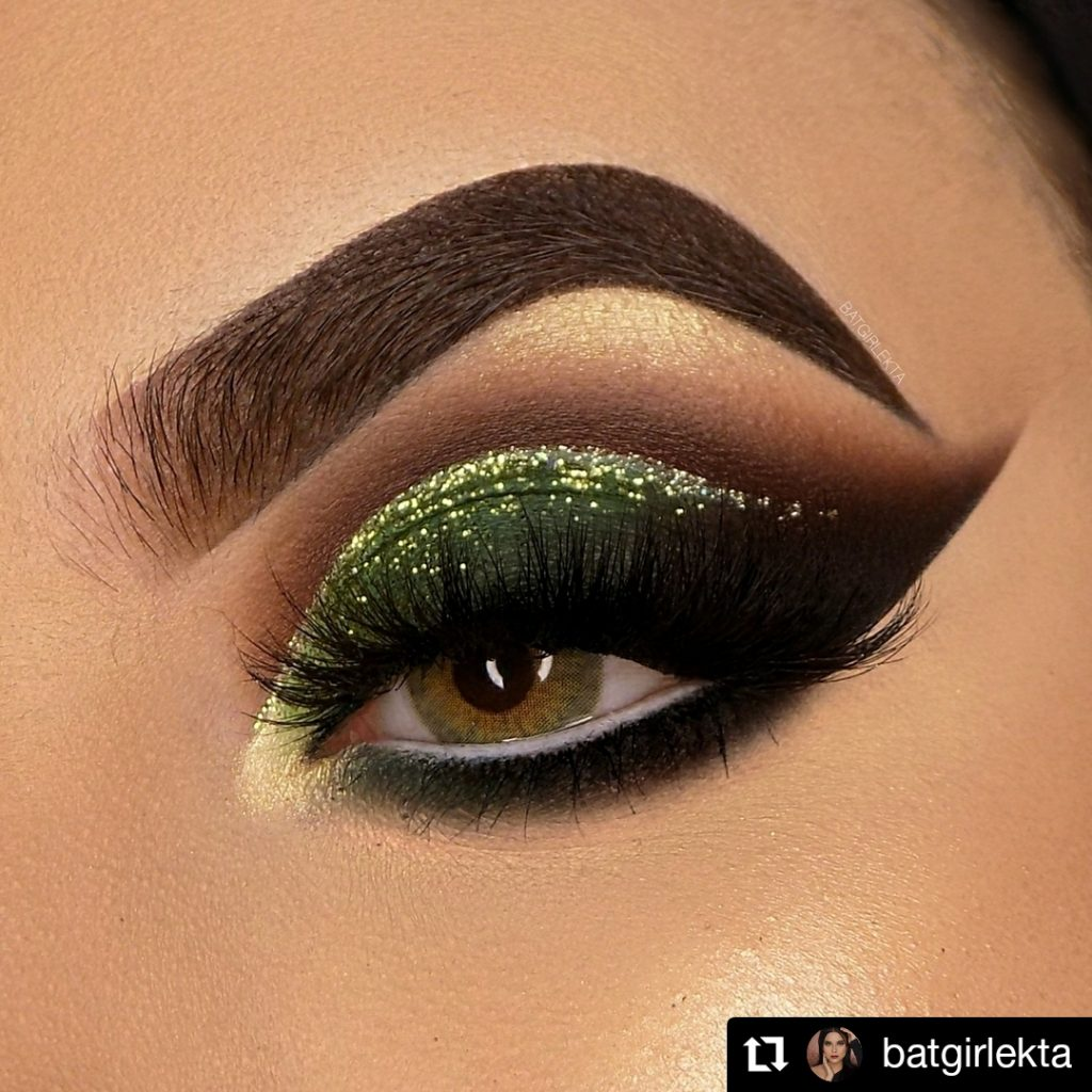 Dramatic Black And Green Christmas Eye Makeup Look